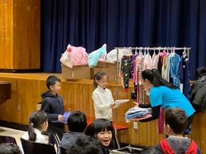 students presenting pajamas at assembly