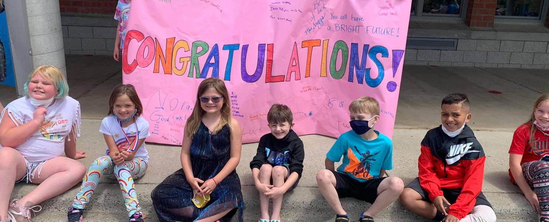 Students with Congratulations sign