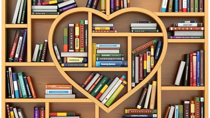 Picture of bookshelf with heart shelf at the center.