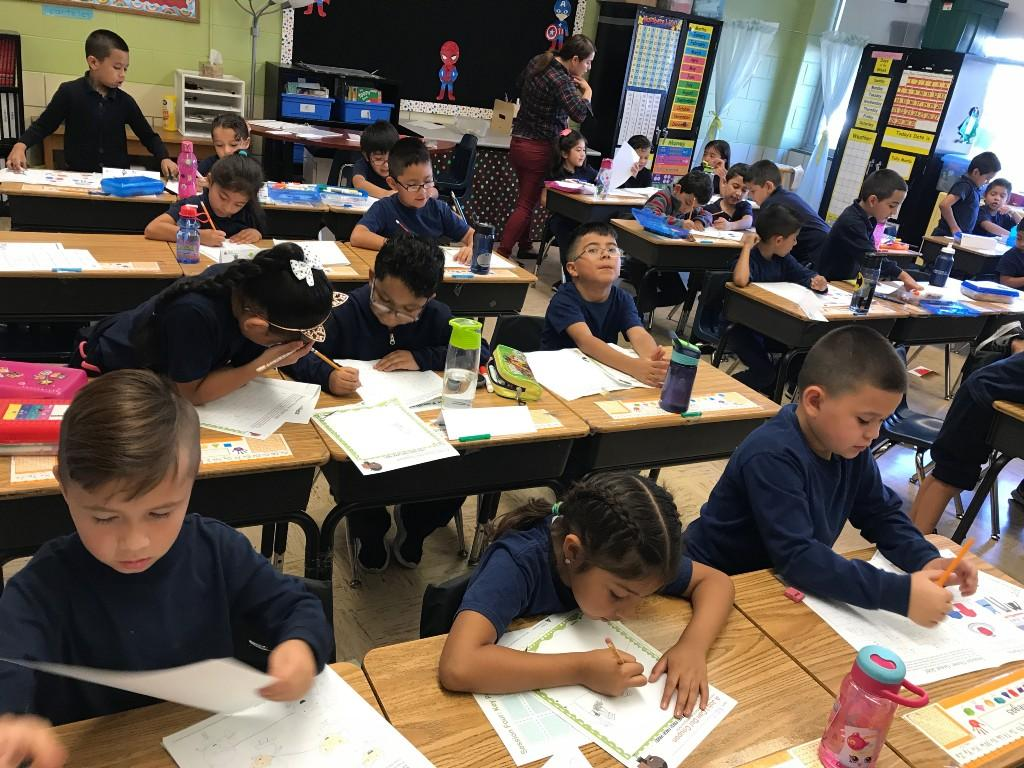 First grade works in their journal