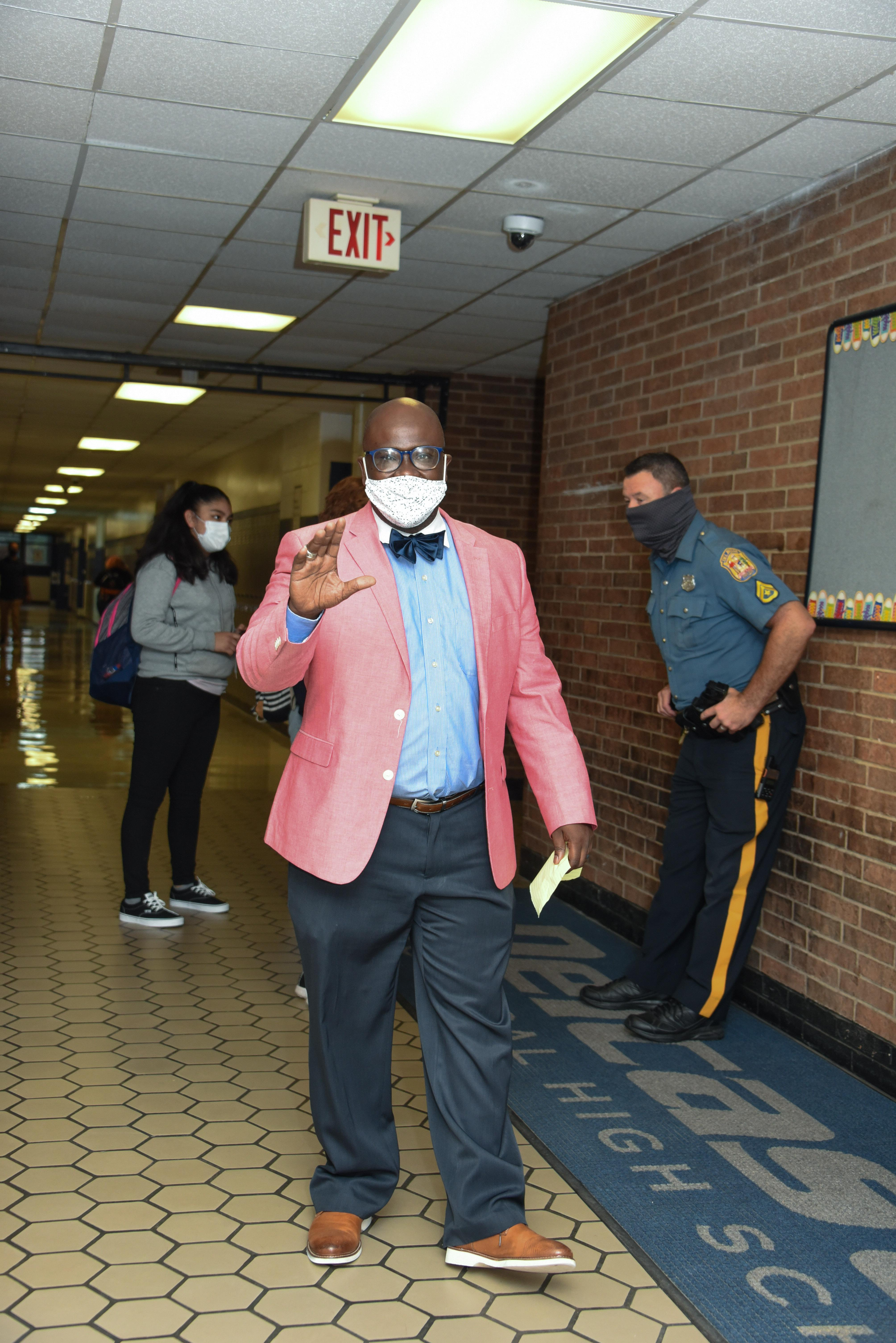 Dr. Hayes greeting students on the first day of school.
