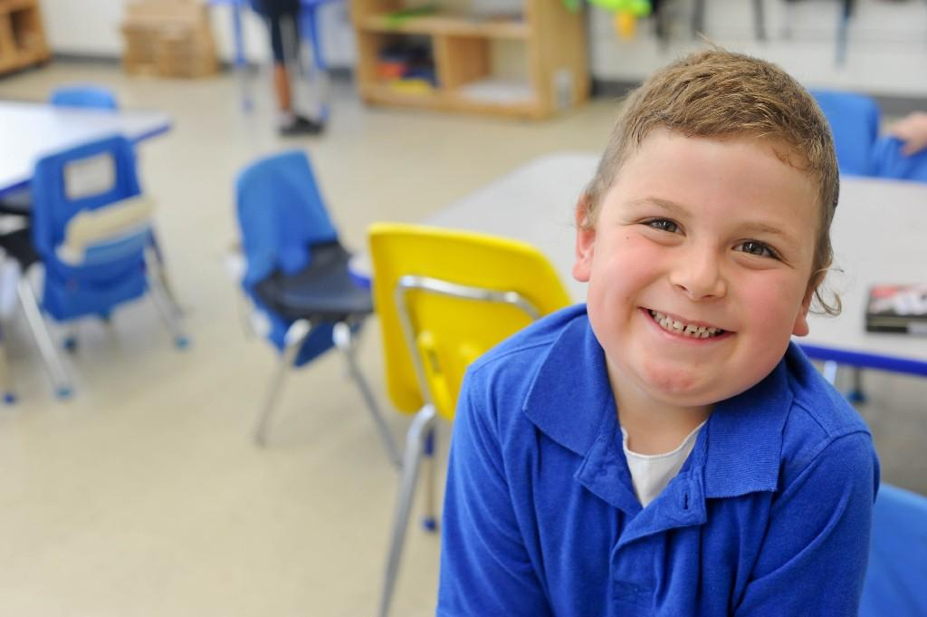 boy smiling in classroom