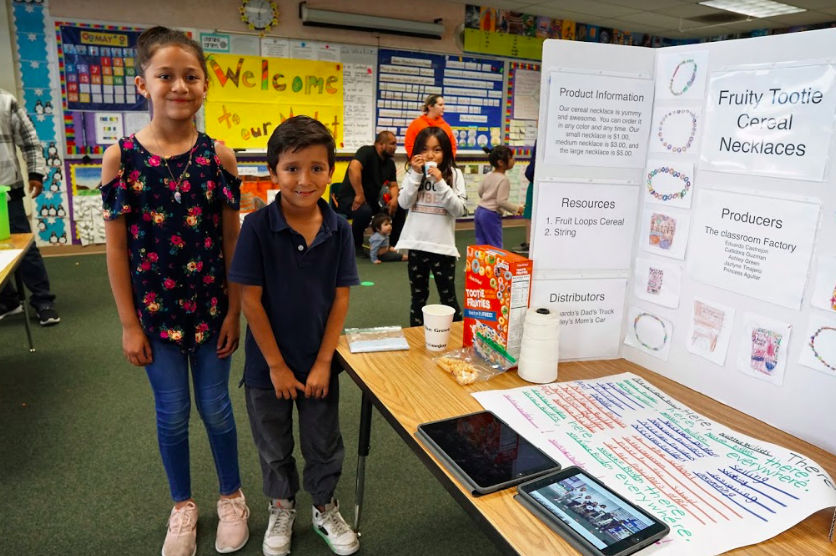 students stand near fruity tootie cereal necklace display