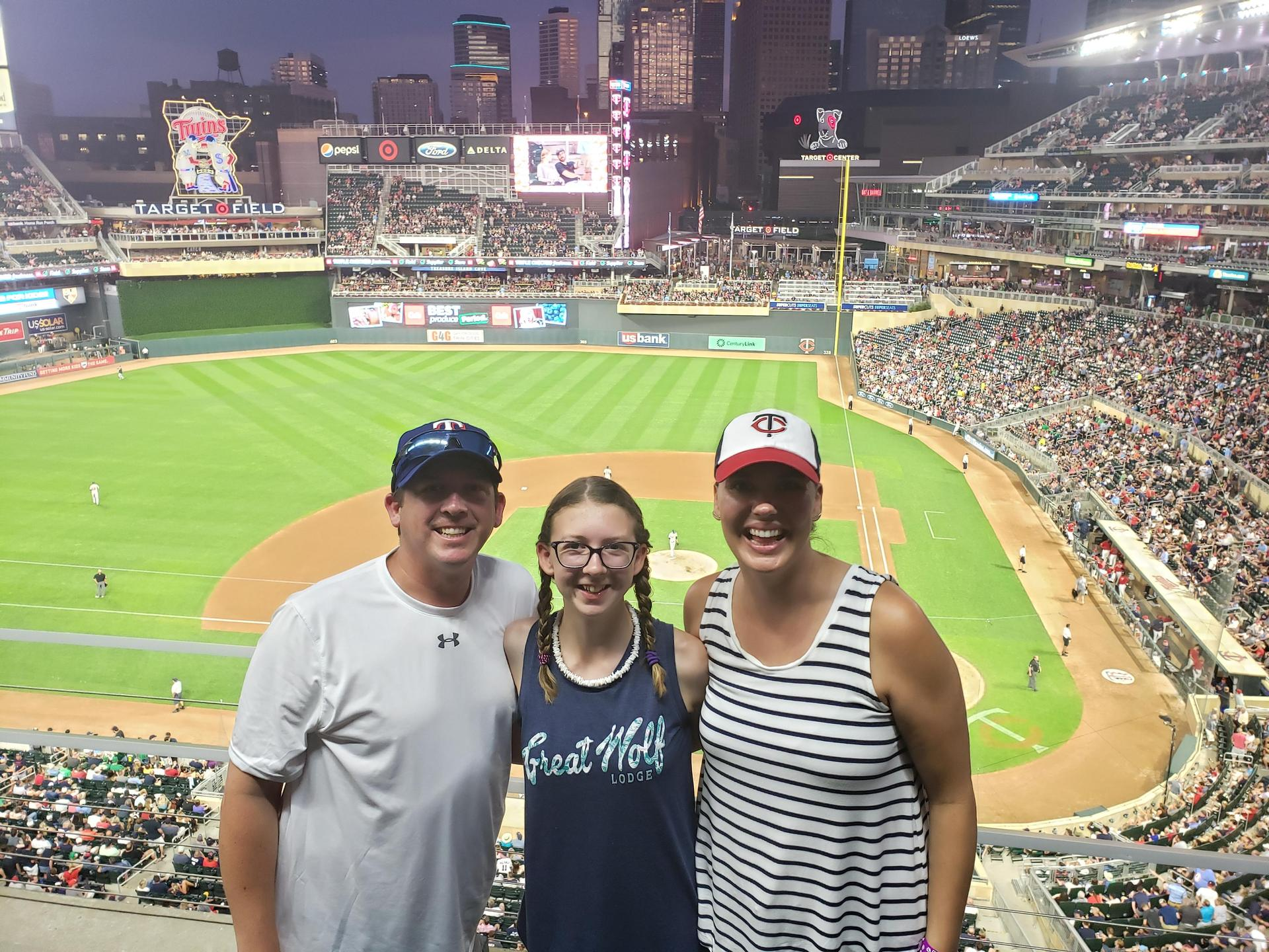 man, woman and girl pose in front of Target Field