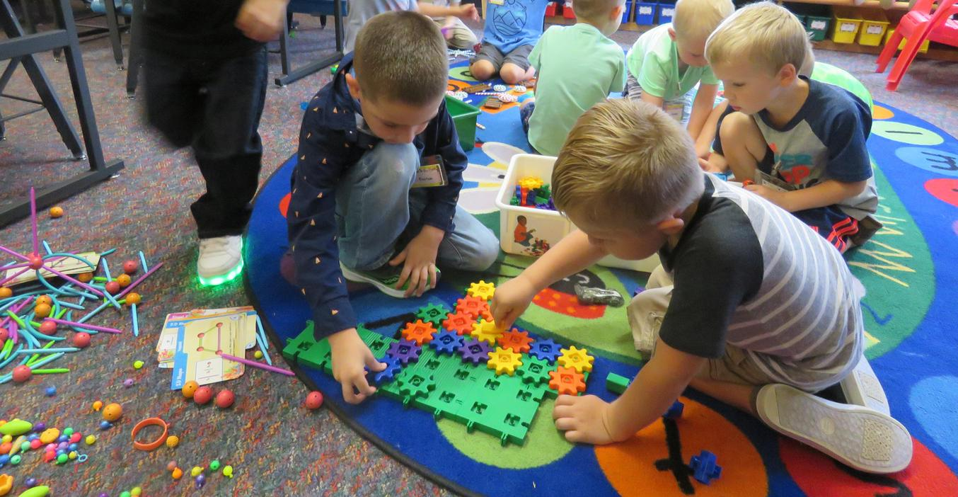 Kindergarten students enjoy some play time working with gears.