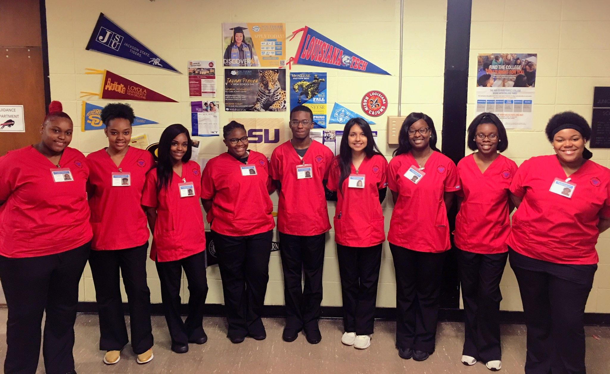 Photo of Baker High School's 1st Nursing Assistant Class standing in a semi circle
