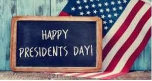 Happy President's Day written with white chalk on a black chalboard.  US flag draped in the background