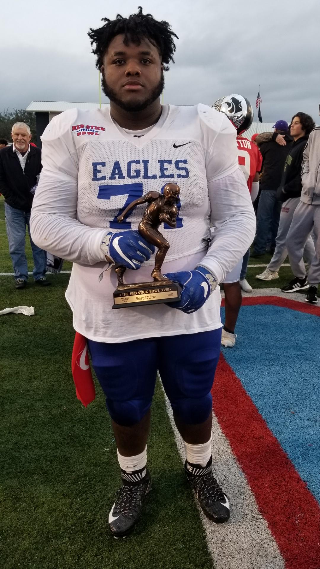 a photo of Dillion Cage as winner of the Defensive MVP award at the Red Stick Bowl 2019