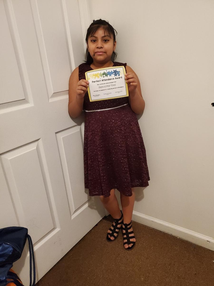 Bianca Martinez holding perfect attendance certificate