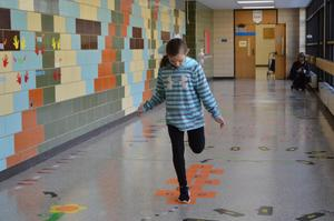 A girl jumps thought Hopscotch in the Sensory Path