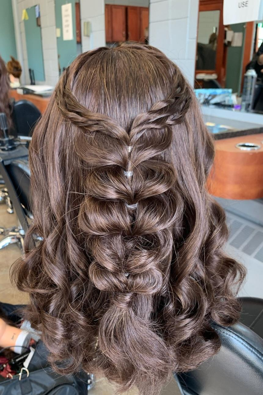 Hairstyle presented by Cosmetology student.