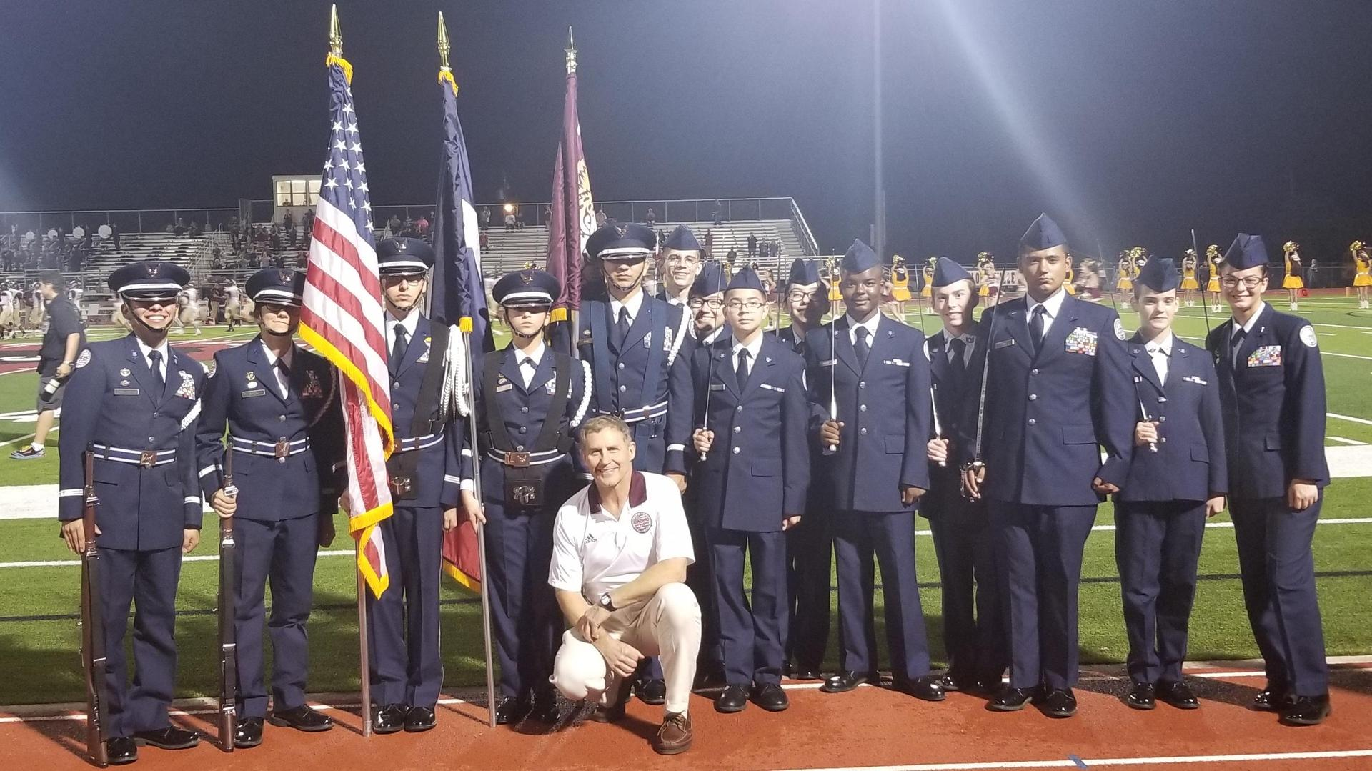 ROTC members with Colonel Rakel at a Tiger football game
