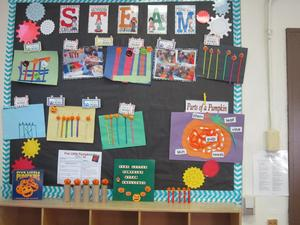 STEAM bulletin board with photo of the students structures