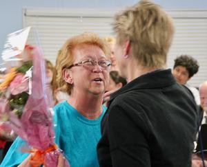 school board DI april woman giving flowers 1.jpg
