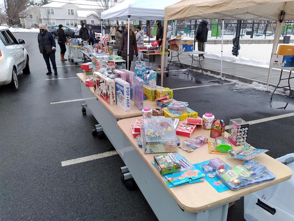 A wide angle view of two tables filled with new toys