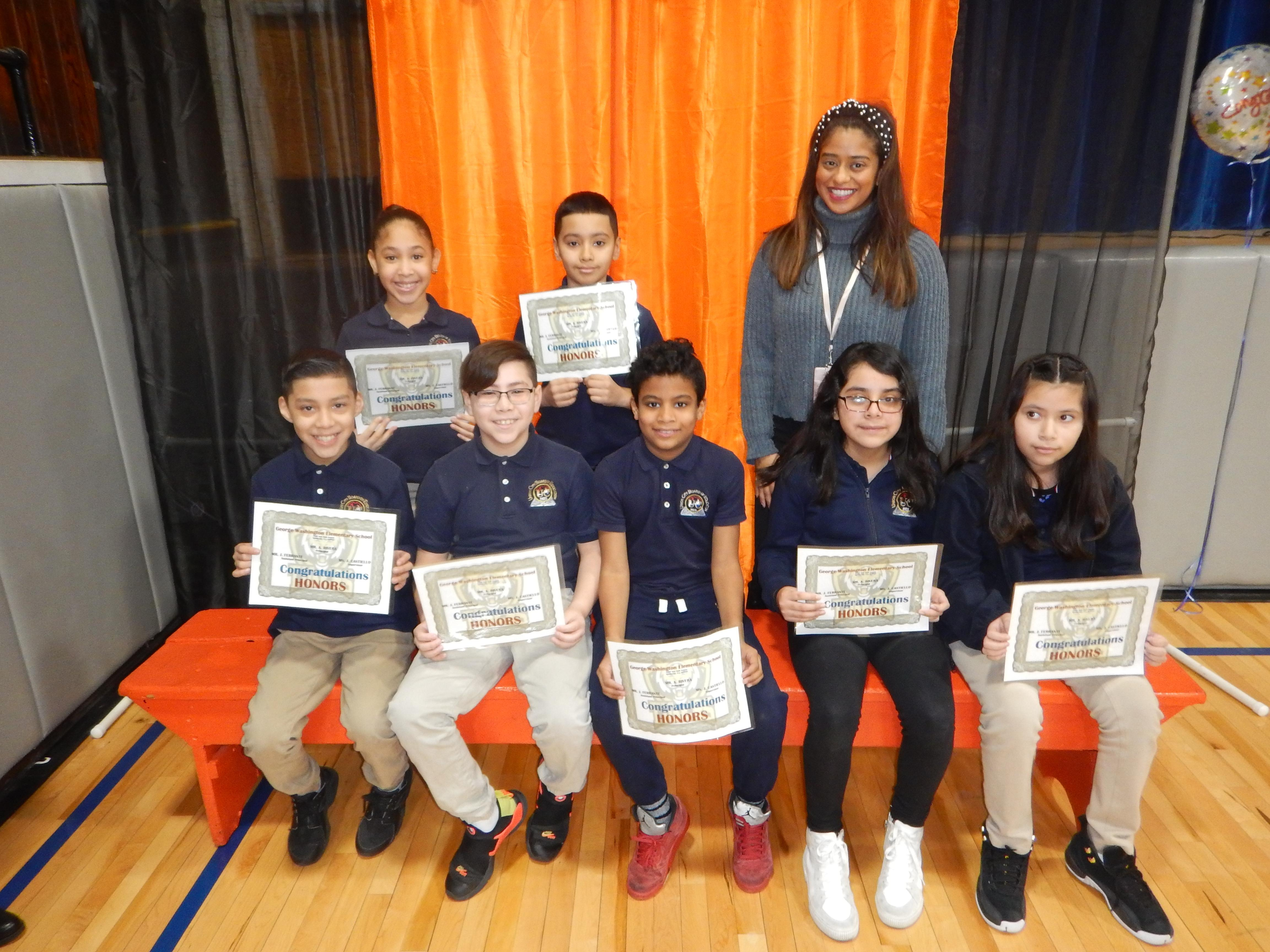 7 Honor Roll Students with their Teacher and certificates