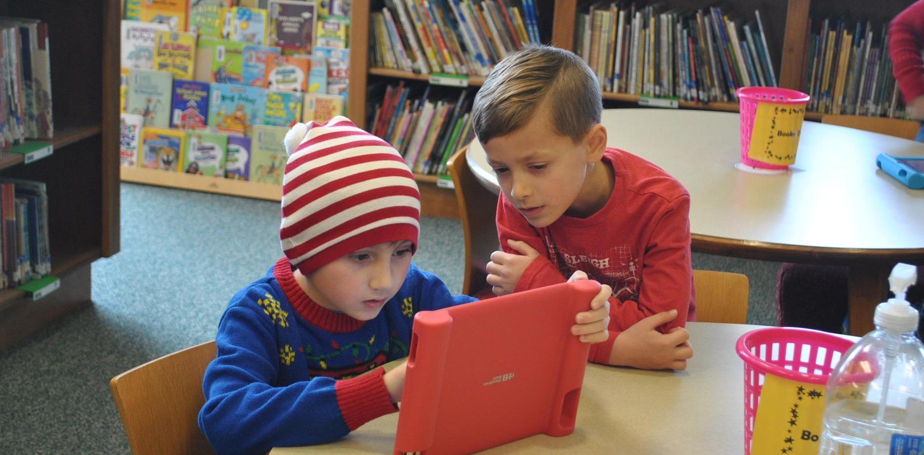Students reading on ipad