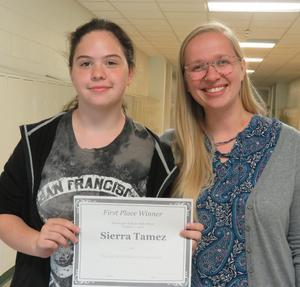 Sierra Tamez (left) accepts the top prize for the TKHS Freshman writing contest from her teacher Hailie Roblyer.