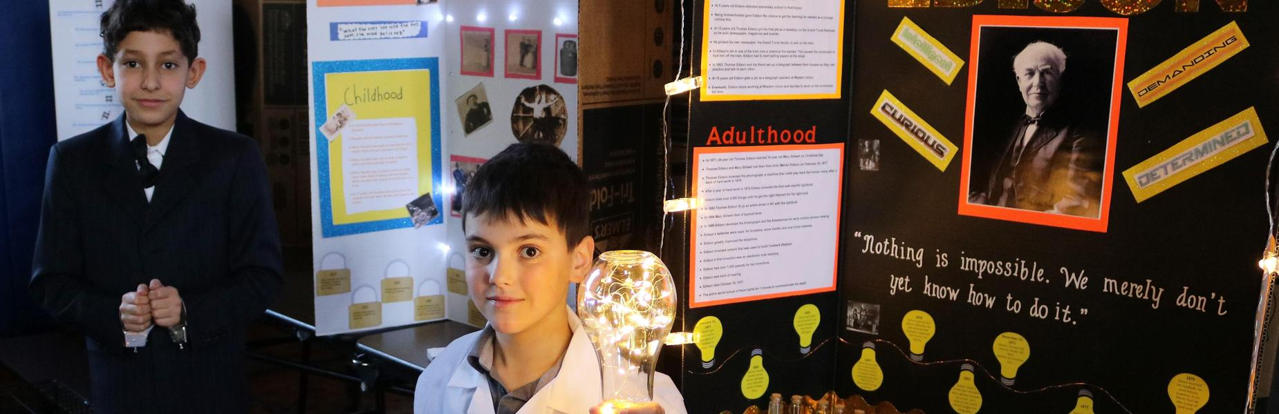 Photo of two Wilson 5th graders as Thomas Edison and Harry Houdini at annual