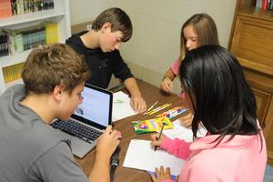 Middle School English students work on a project.