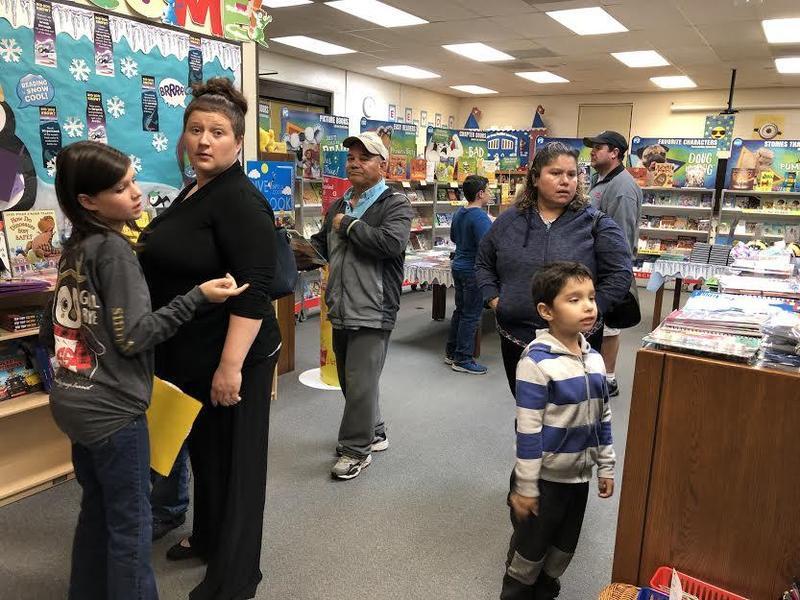 Families visiting Book Fair.