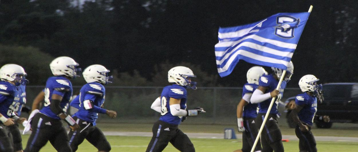 CHS Football players with flag