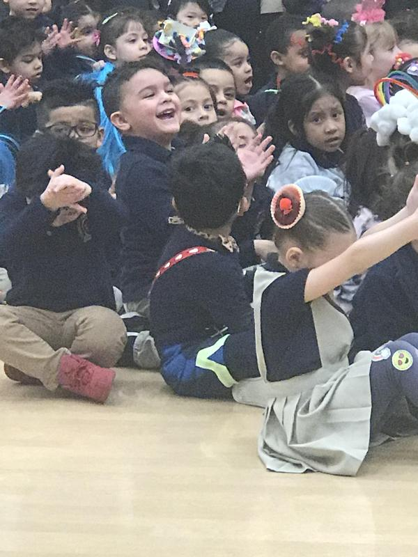 children laughing and clapping