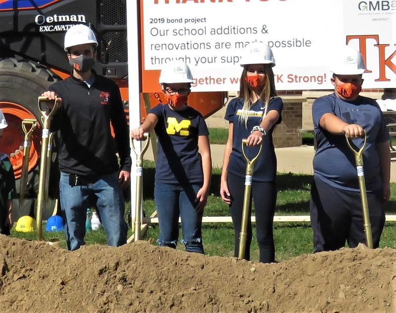 Page Principal and three students take part in groundbreaking ceremony.