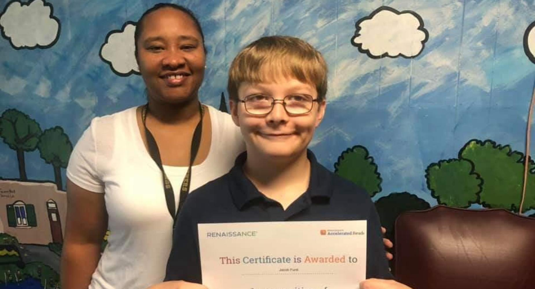 ACCELERATED READER STUDENT OF THE WEEK PICTURED WITH MRS. HUNT