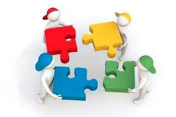 image of figures playing with large puzzle pieces