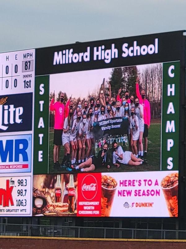 Scoreboard at Fisher Cats stadium displaying Soccer team championship photo