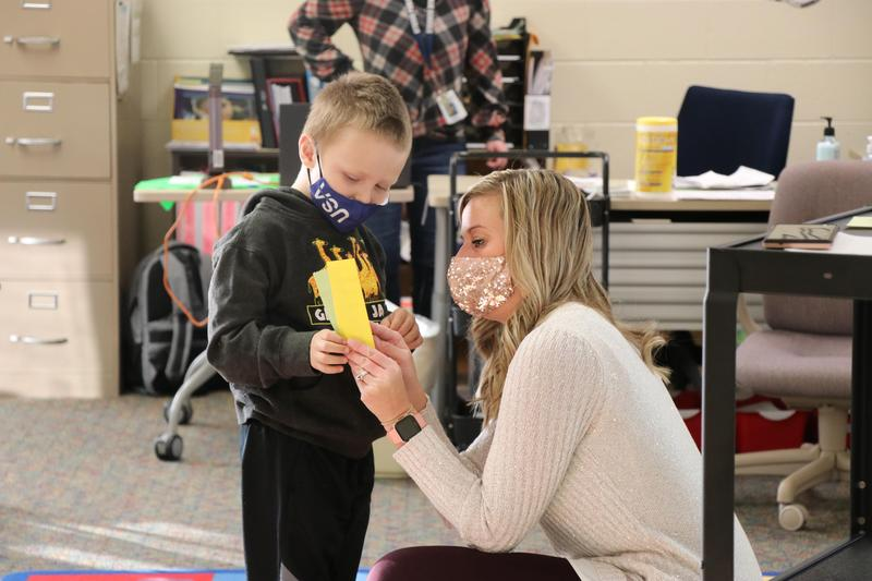 Mrs. Knight giving a student his ribbons