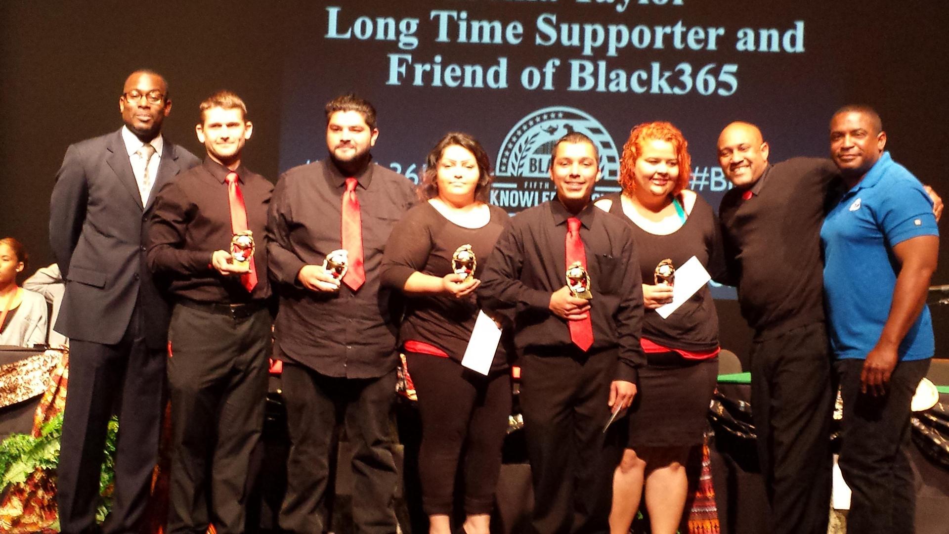Palmdale students holding Black Knowledge Bowl awards