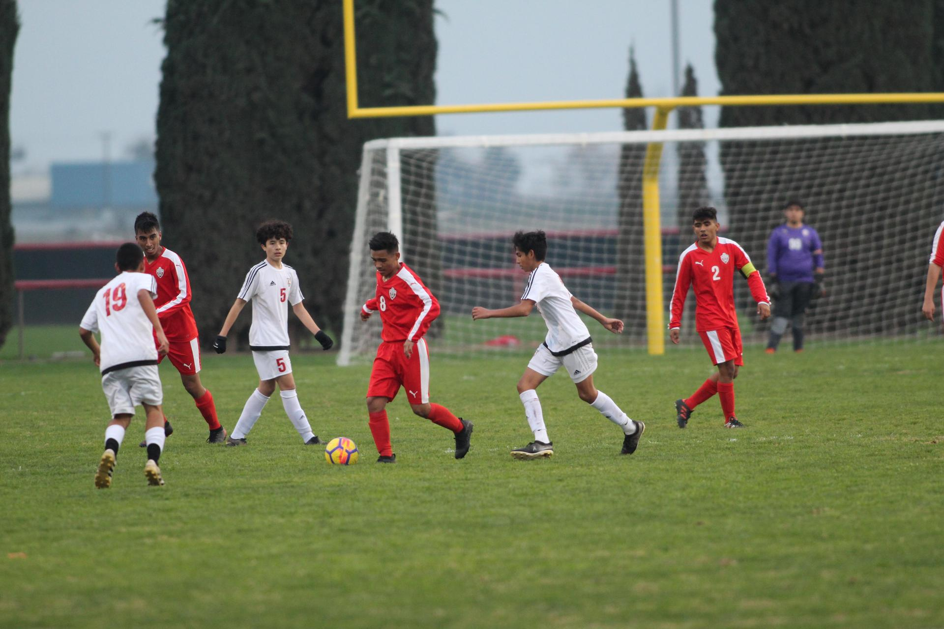 Junior Varsity boys playing soccer against McLane