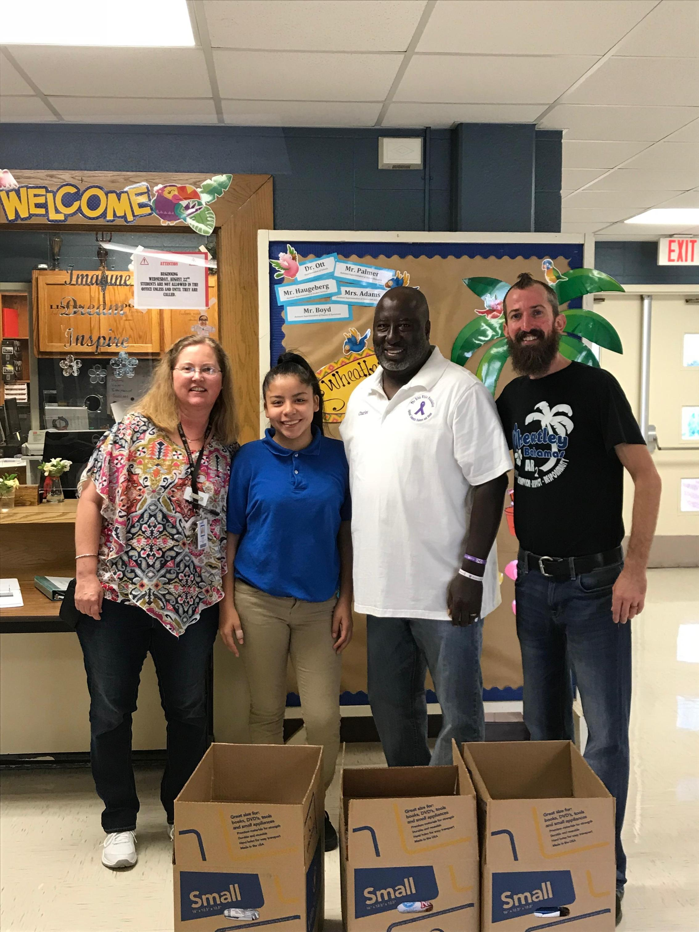 Ms. Stein, Wheatley student, Mr. Shores Mr. Oliver image