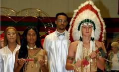 AHS maiden and Indian mascots at the graduation ceremony