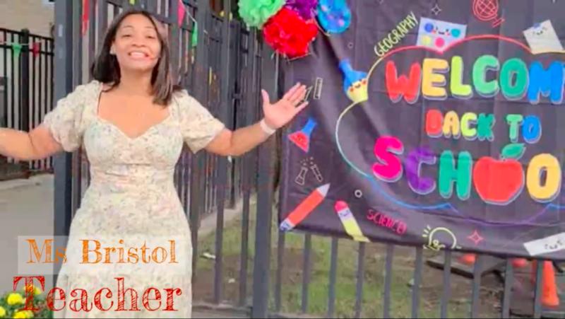 Ms. Bristol outside school smiling