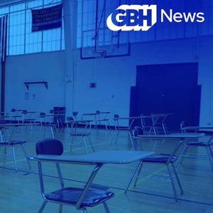 A classroom set against a blue screen effect