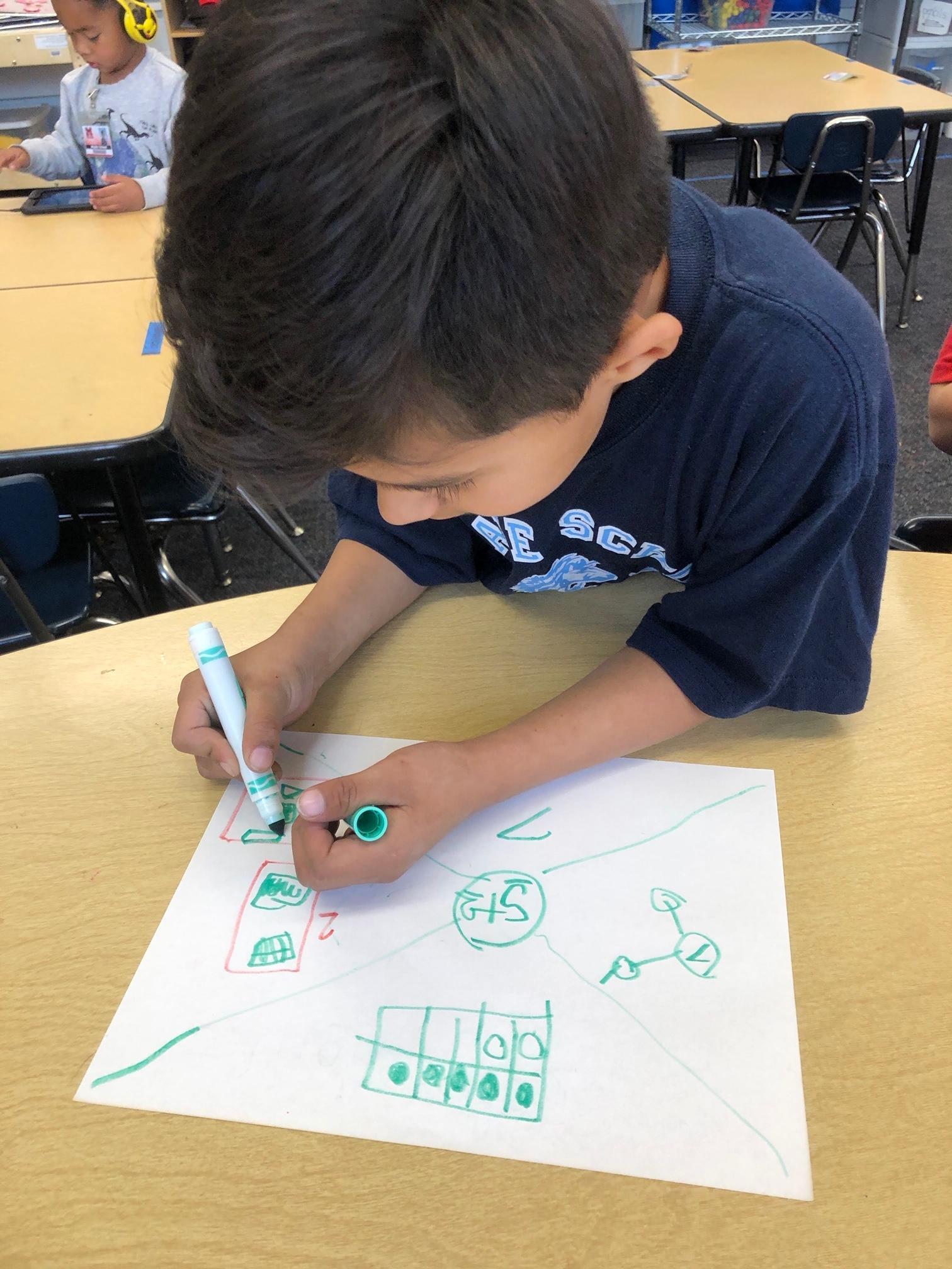 A TK student problem solves in Math Workshop.