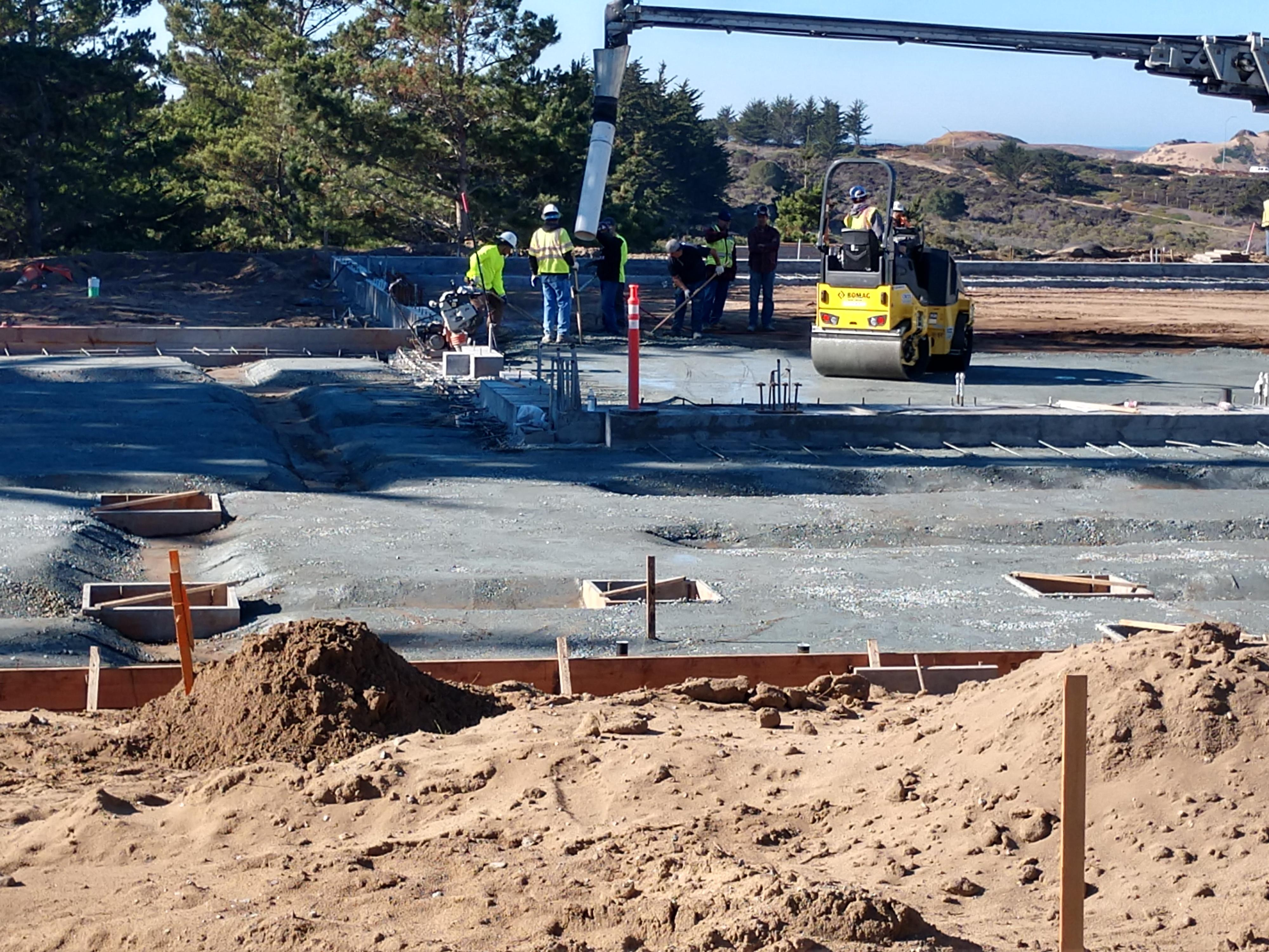 Picture of concrete being poured for the new gym.