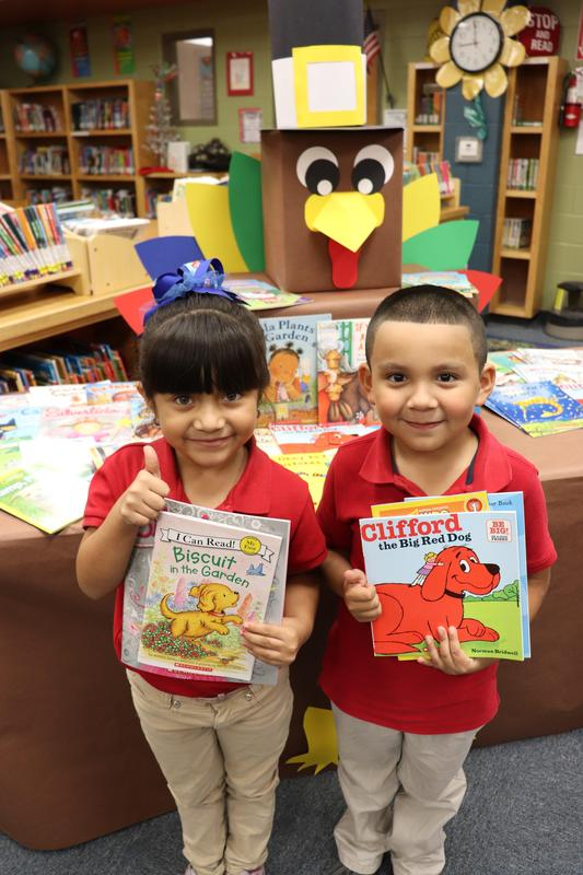 Image of 1st grade students with RIF books