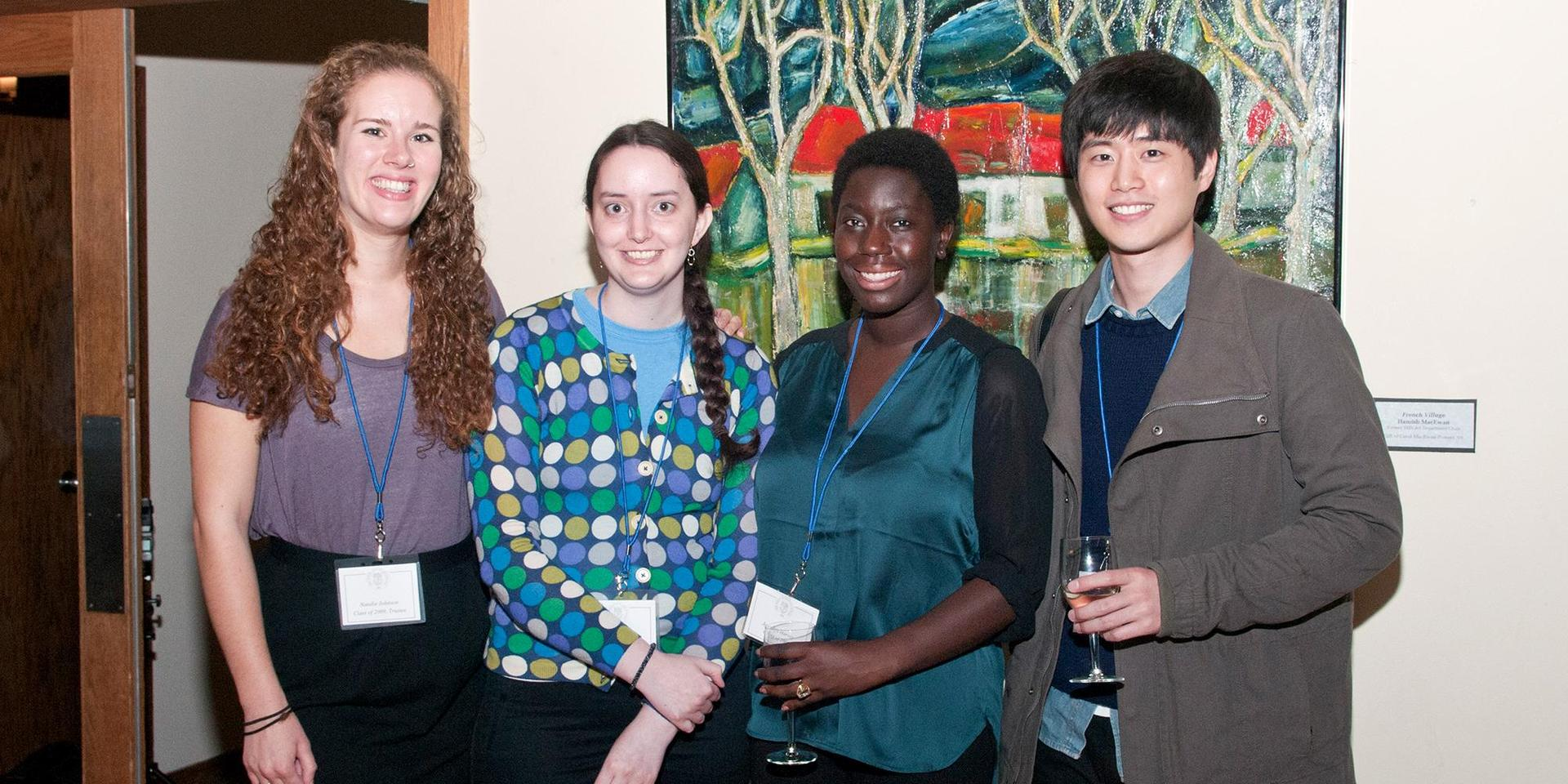 A group of young alumnae/i at the reception.