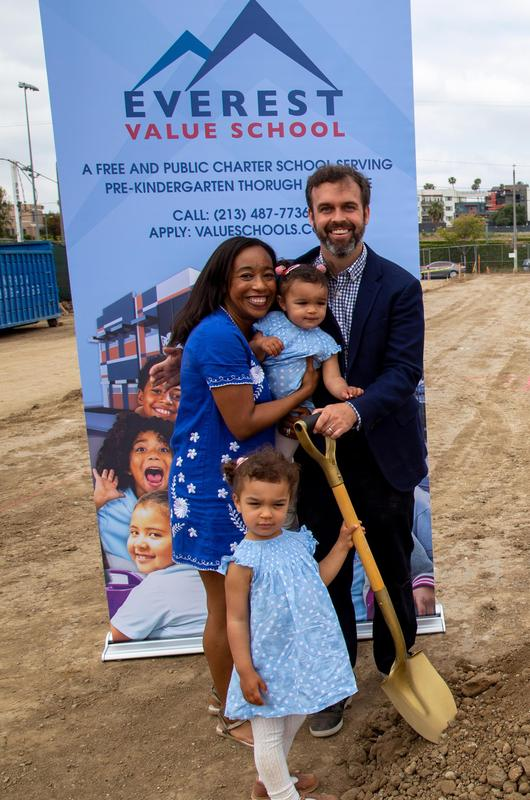 Principal Chris Medinger with his family during Everest Value School's groundbreaking.