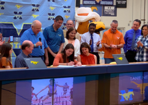 Student Lanie Nitsch signing her letter of intent surrounded by family