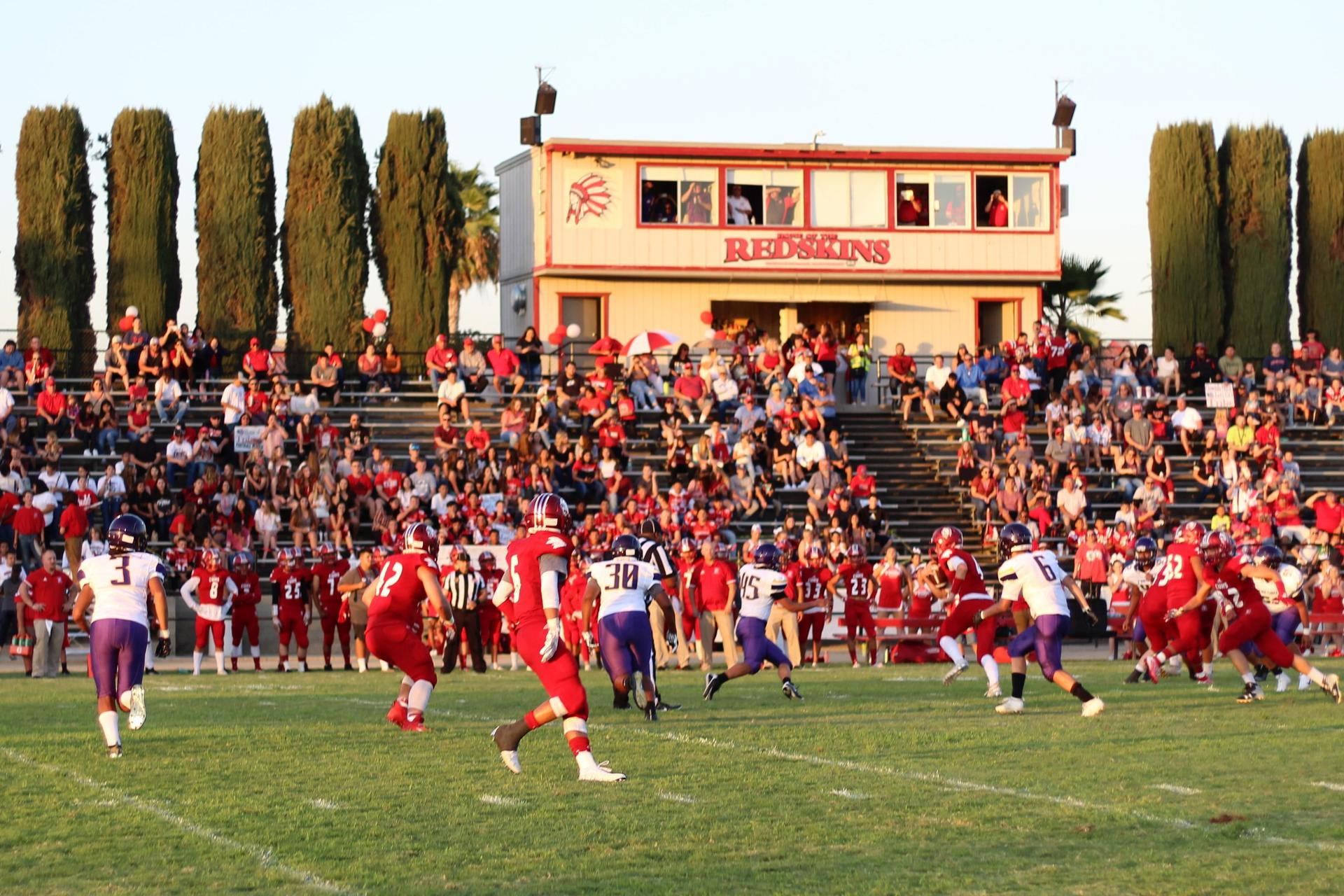 Varsity boys playing football against Fresno