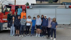 Students get an escort out of town by the Ouray fire