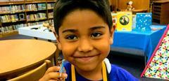 Boy with Lego boy in library