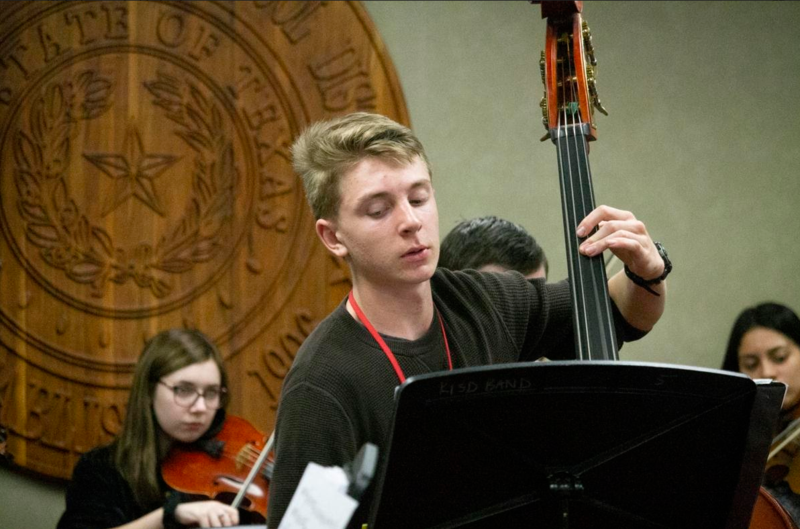 Orchestra Plays at School Board Meeting Featured Photo