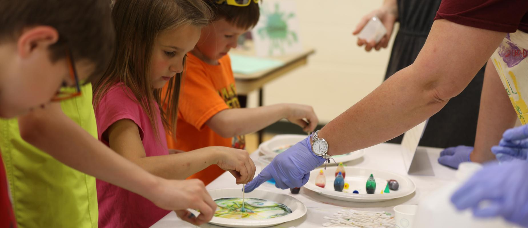 making swirly artwork with food coloring