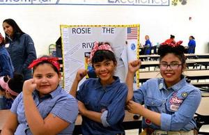 Students dressed as rosie the riveter